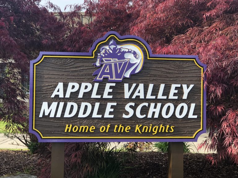 School sign at entrance