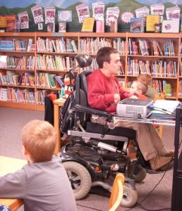 Volunteer reads to class