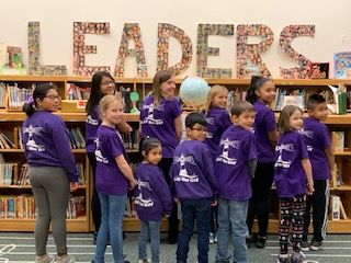 Students show shirts that read Wildcats Light the Way