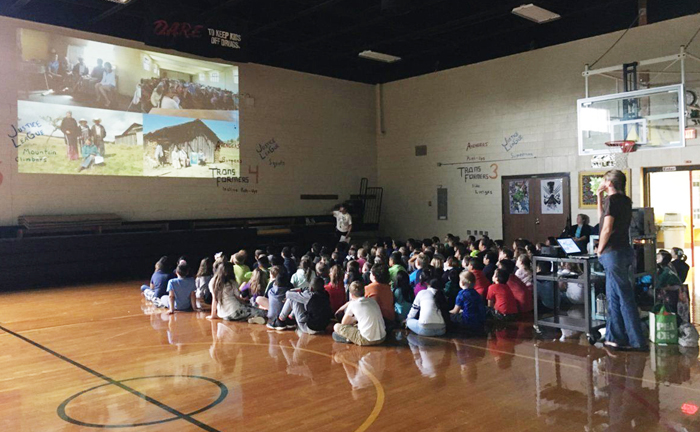 Estela Romero, who lives in Angangueo, Mexico near the El Rosario monarch overwintering sanctuary speaking to Edneyville students about the migration