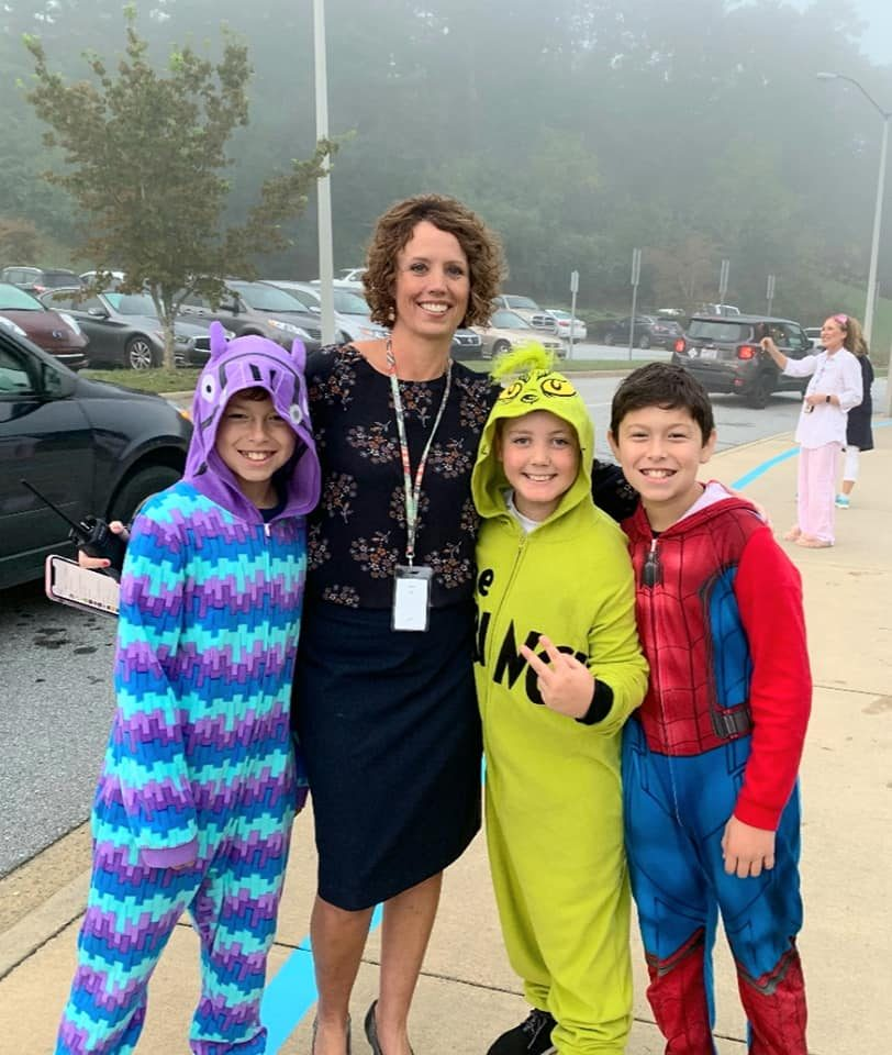Principal, Tammy Deaver, with 3 Fletcher Students in their Pajamas for Pajama Day