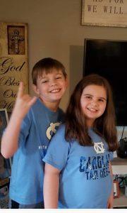 2 students in team spirit shirts