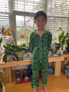 A student in his pajamas