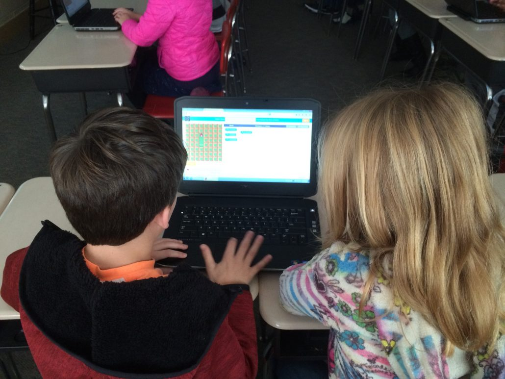 2 students at a Chromebook participating in the Hour of Code