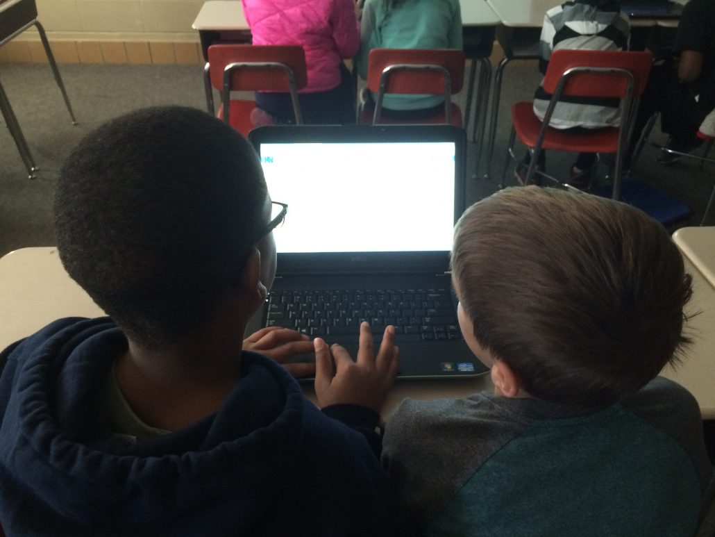 2 students at a laptop doing coding activities