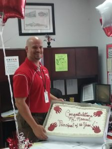 Mr. Manuel pictured with his Principal of the Year cake