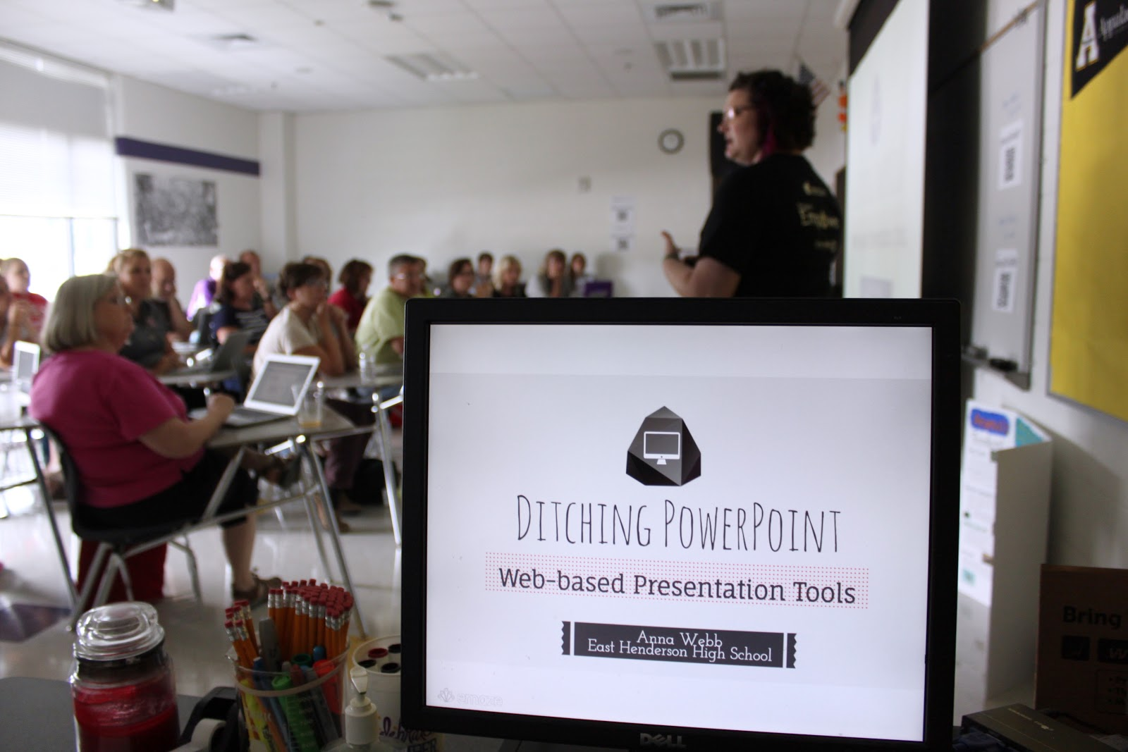 Teacher presenting ideas to teachers for ditching PowerPoint