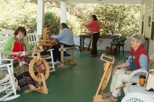 Spinners and weavers working.