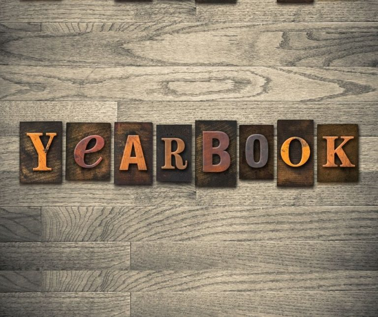 Wood background with blocks spelling out yearbook