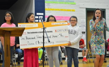 Dana students present oversized check to LLS