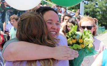 2017 Teacher of the Year hugging students