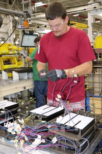 GE staff worker connects wiring