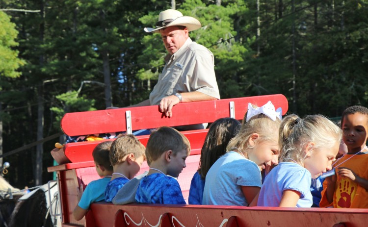 Students ride a wagon.
