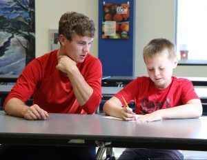 North student mentors younger student