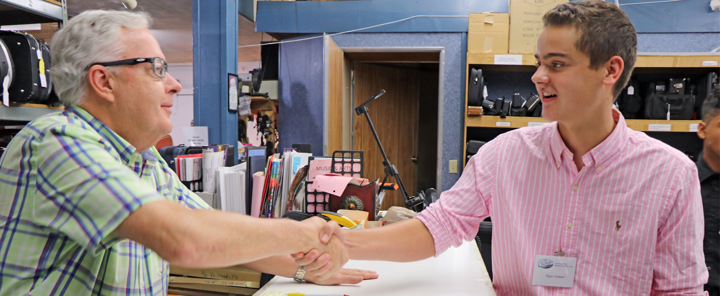 Student shaking hands