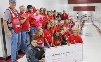 Hendersonville Middle students with oversized check