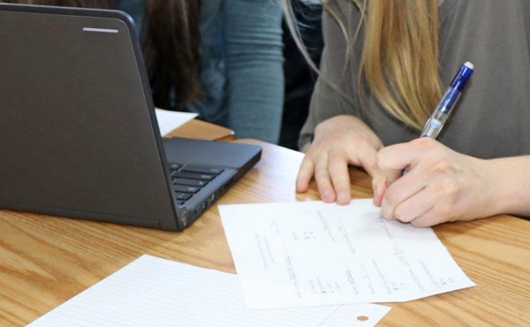 Students peer editing writing.