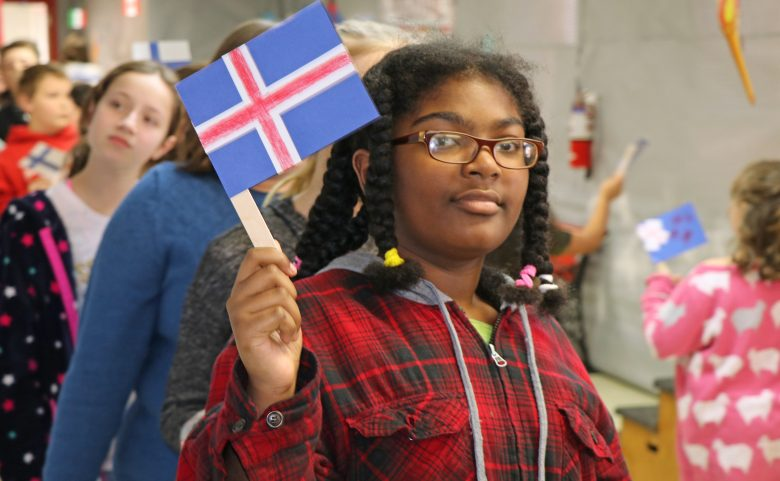 Student holding a country's flag