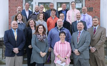School administrators with Henderson Oil Company executives.