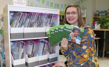 Kindergarten teacher with books