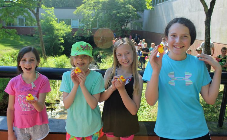 Students with rubber ducks.