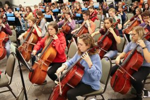 Cellists practice for the Berrian All-County Orchestra Festival