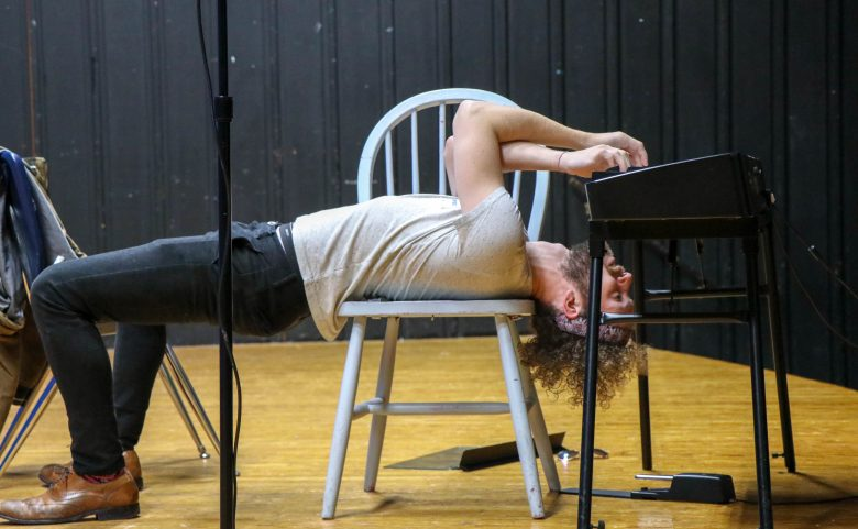 Nat Zegree plays the keyboard upside down at West Henderson High