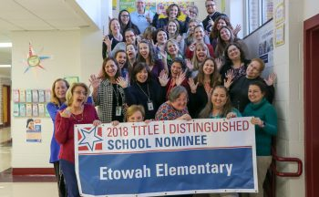 "Etowah Elementary staff with ""2018 Title I Distinguished School"" Nominee sign"