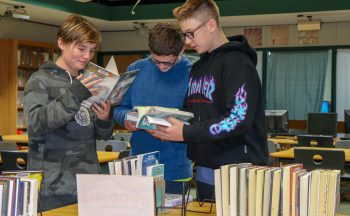 Students read library books