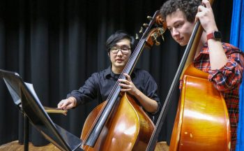 Students and upright basses
