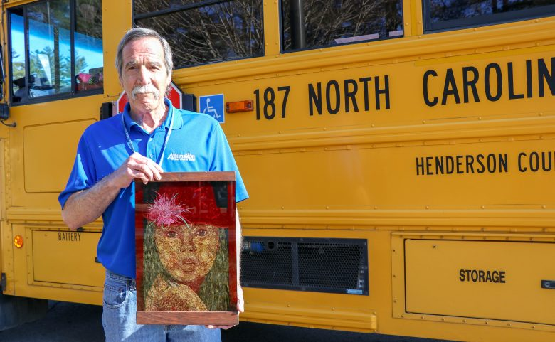 Bus driver Gary Kutch with a piece of his artwork
