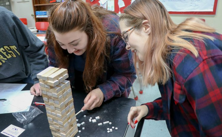 Students play Jenga