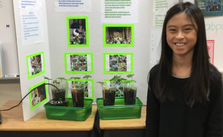 student with science project display board