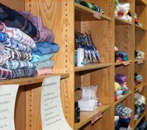 stacks of clothing on shelves
