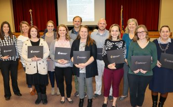 12 teachers holding certificates