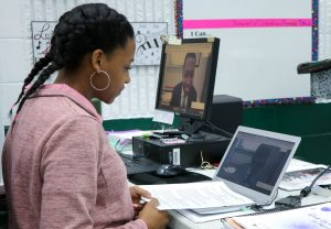 female student video chatting with composer