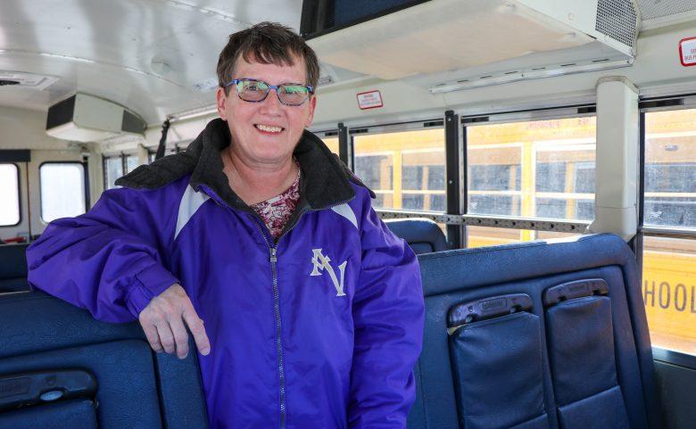 woman standing in school bus