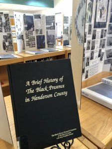 "book titled ""A Brief History of The Black Presence in Henderson County"""