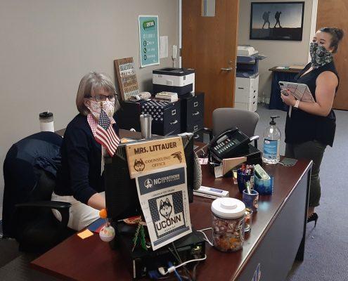 two women in office wearing masks