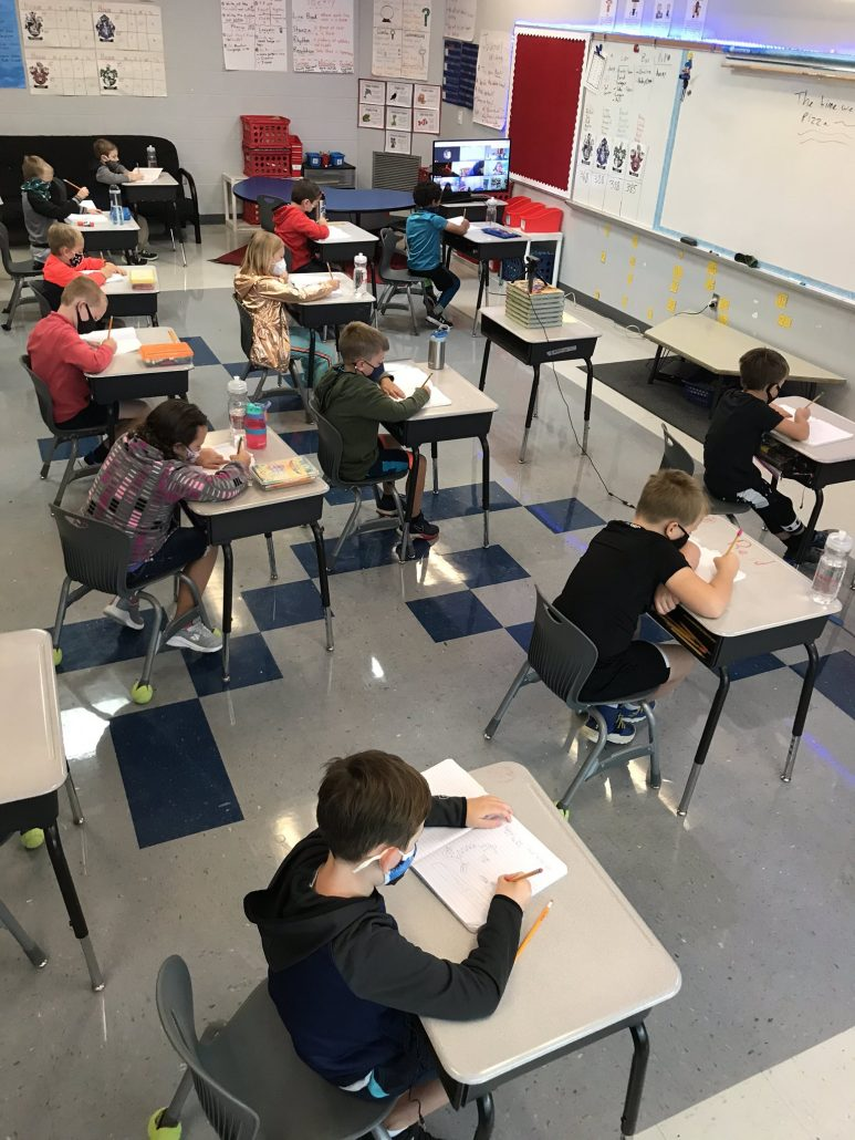 students in desks spaced out