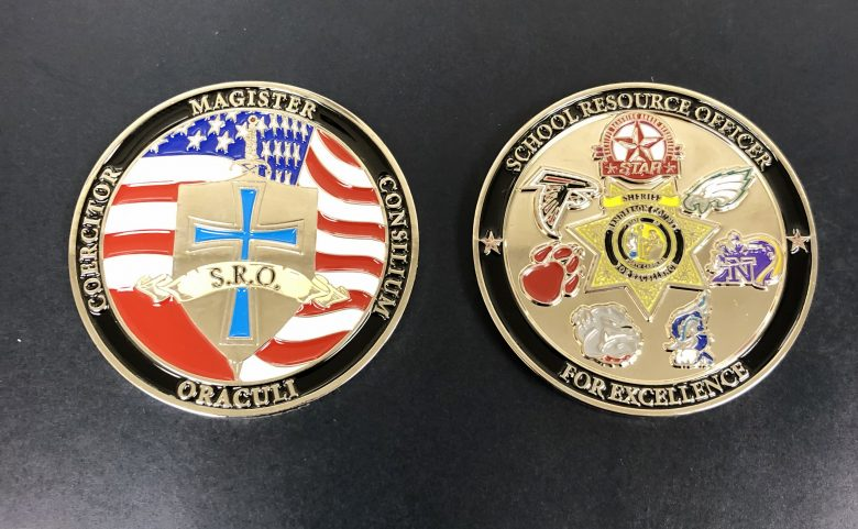 front and back of the SRO challenge coin from the Henderson County Sheriff's Office