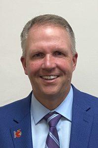 headshot of Scott Rhodes