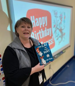 "Jan King holding ""Cat in the Hat"" book"