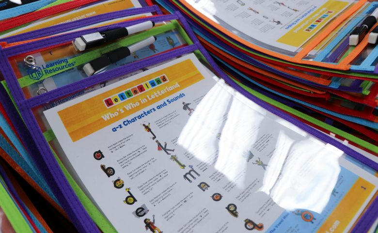 sheets of Letterland characters in plastic protectors